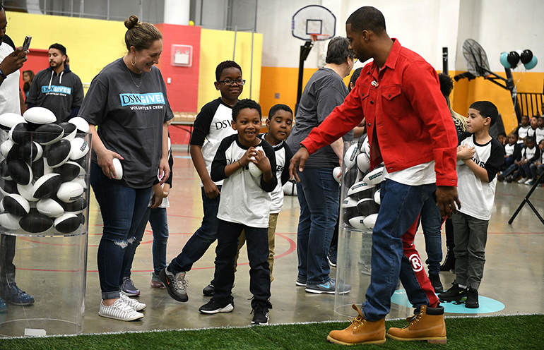 Soles4Souls-Victor-Cruz-with-kids.jpg