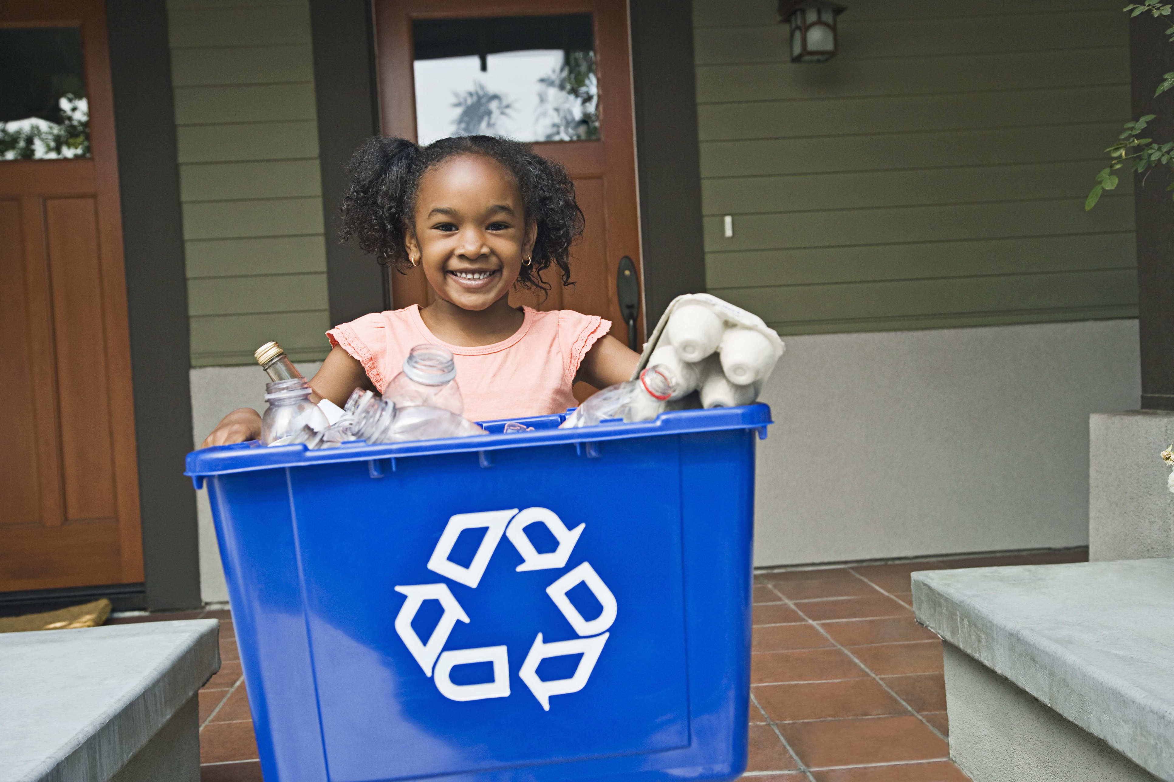 Girl with recycling bin