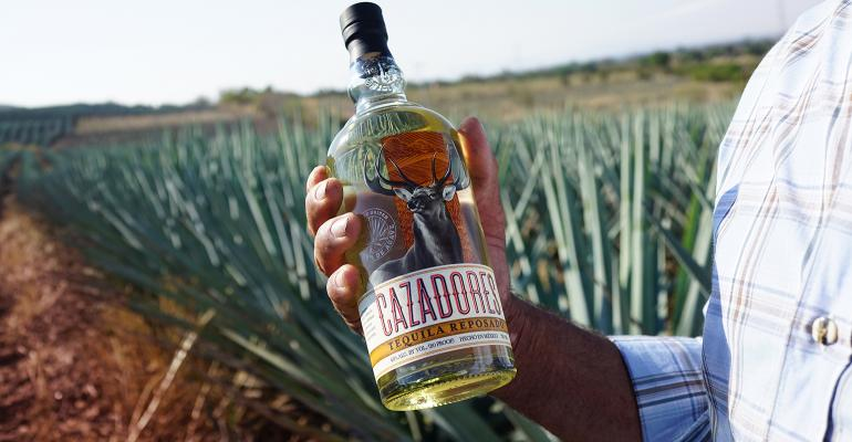 Cazadores_Agave-Lifecycle_Agave-Field-Reposado-Jimador-Hand.jpg