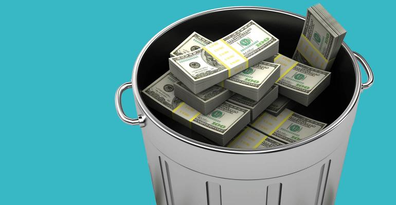 money in garbage can
