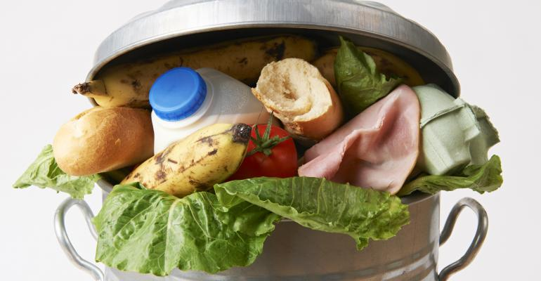 food waste - fresh food in a garbage can