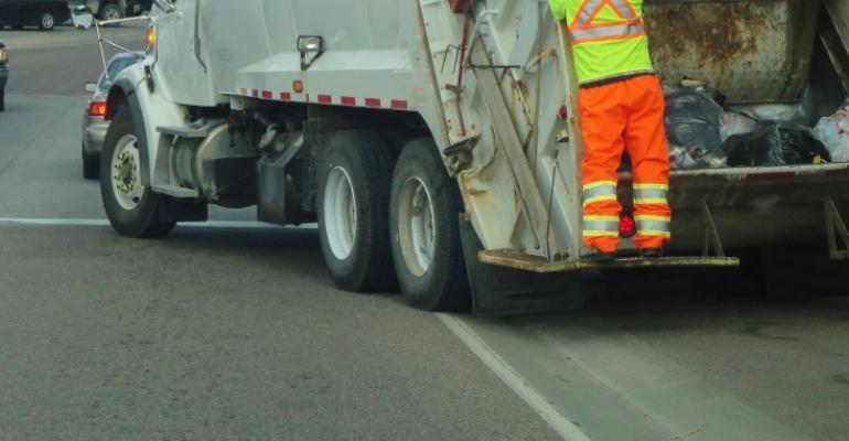 garbageman-on-truck.jpg