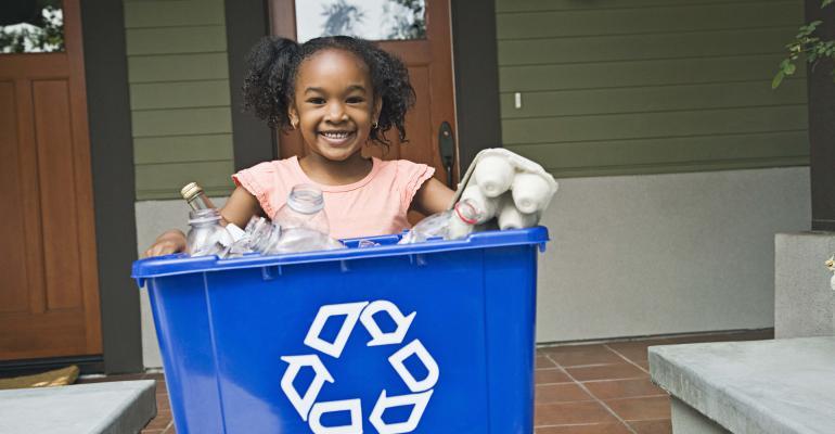 Girl with recycling bin