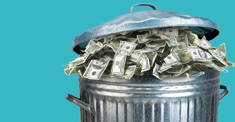 money in trash can