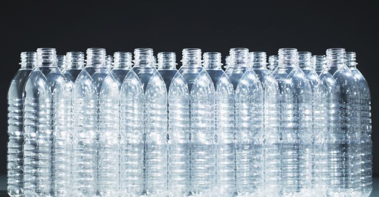 plastic-bottles-all-same-empty-blk-bkgd-TS.jpg