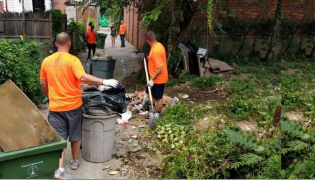 Traveling Trash Men Take on Cleanup Effort in Baltimore